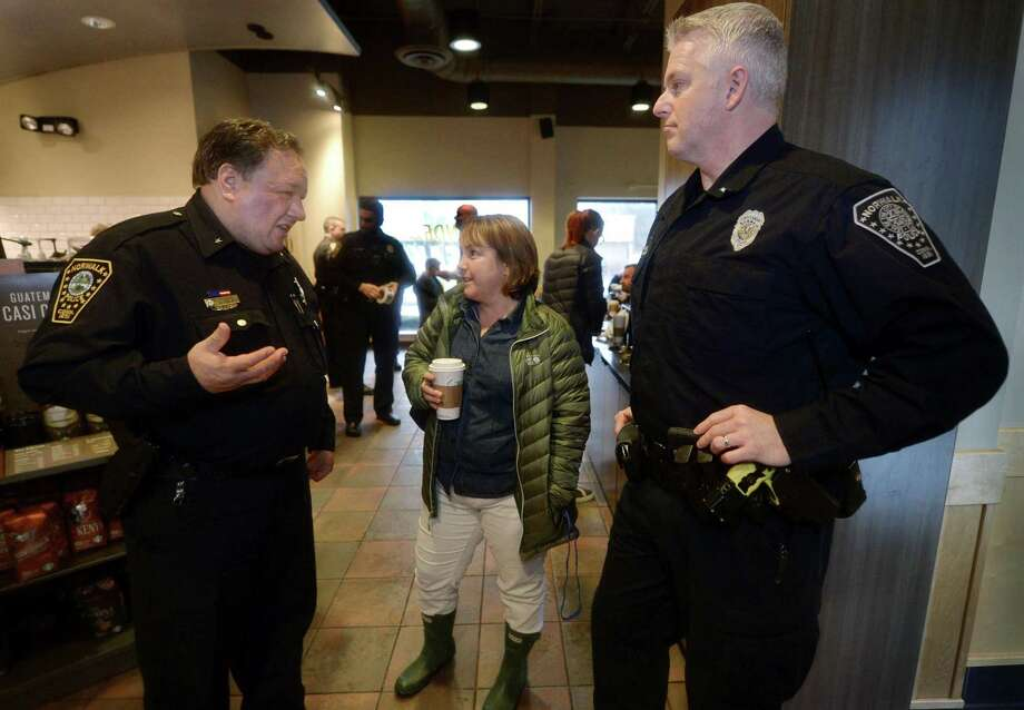 Deputy Chief Ashley Gonzalez and Lt. Terry Blake chat with Lisa Lenskold during the police department's Coffee with a Cop event Friday at Starbucks on Westport Avenue in Norwalk. Photo: Erik Trautmann / Hearst Connecticut Media / Norwalk Hour