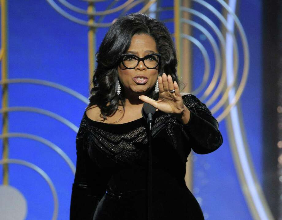 This image released by NBC shows Oprah Winfrey accepting the Cecil B. DeMille Award at the 75th Annual Golden Globe Awards in Beverly Hills, Calif., on Sunday, Jan. 7, 2018. (Paul Drinkwater/NBC via AP) Photo: Paul Drinkwater / Associated Press / 2018 NBCUniversal Media, LLC