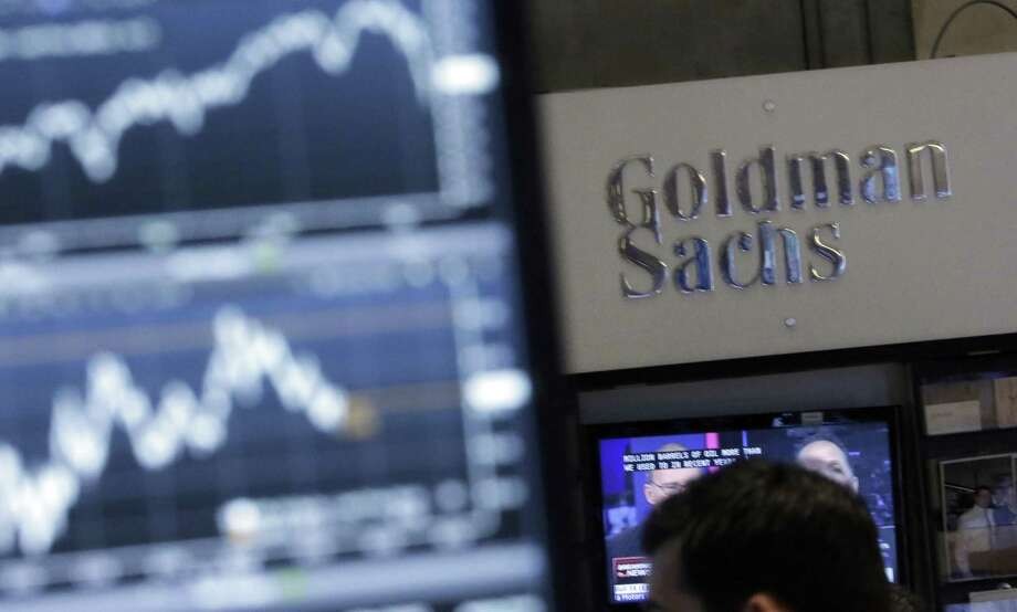 In this Oct. 16, 2014, photo, a screen at a trading post on the floor of the New York Stock Exchange is juxtaposed with the Goldman Sachs booth. Goldman Sachs will start offering home improvement loans to borrowers in January 2018, its latest push into the world of consumer lending, a business the bank has avoided for much of its nearly 150-year history. Photo: Richard Drew /Associated Press / Copyright 2016 The Associated Press. All rights reserved.