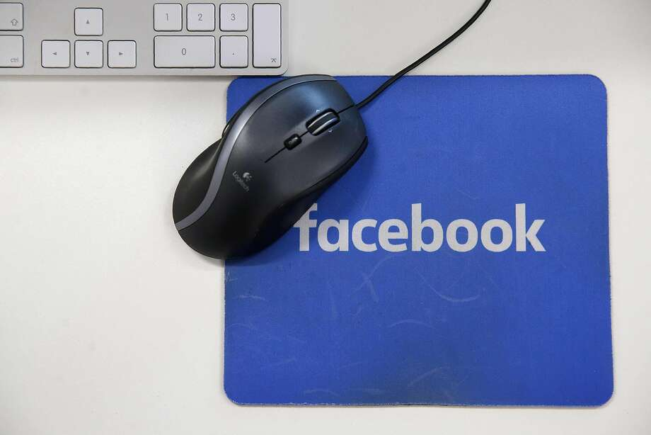 (FILES) This file photo taken on December 4, 2017 shows a mousepad with the Facebook logo  at Facebook's  headquarters,in London. Shares of Facebook tumbled on january 12, 2018 after it announced an overhaul of its newsfeed, while US stocks added to records following data showing higher retail sales in December. About 12 minutes into trading, the Dow Jones Industrial Average was at 25,675.70, up 0.4 percent. Photo: DANIEL LEAL-OLIVAS, AFP/Getty Images