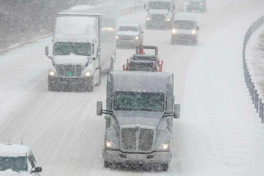 Traffic travels eastbound on Interstate 24 near Paducah, Ky., Friday, Jan. 12, 2018. The winter storm, which began with an icy mix before turning to snow, forced schools and businesses to close in Tennessee and Kentucky. Hardest hit were western sections of both states. (Ryan Hermens/The Paducah Sun via AP) Photo: Ryan Hermens, AP / The Paducah Sun