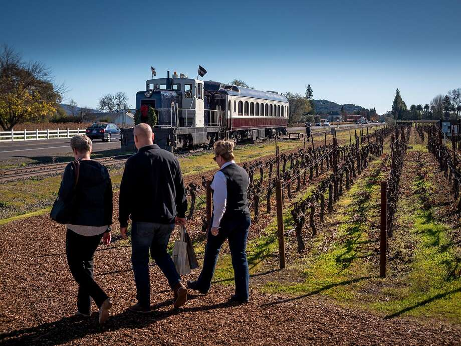 Passengers return to the Napa Valley Wine Train after visiting the Robert Mondavi Winery. Photo: John Storey, Special To The Chronicle