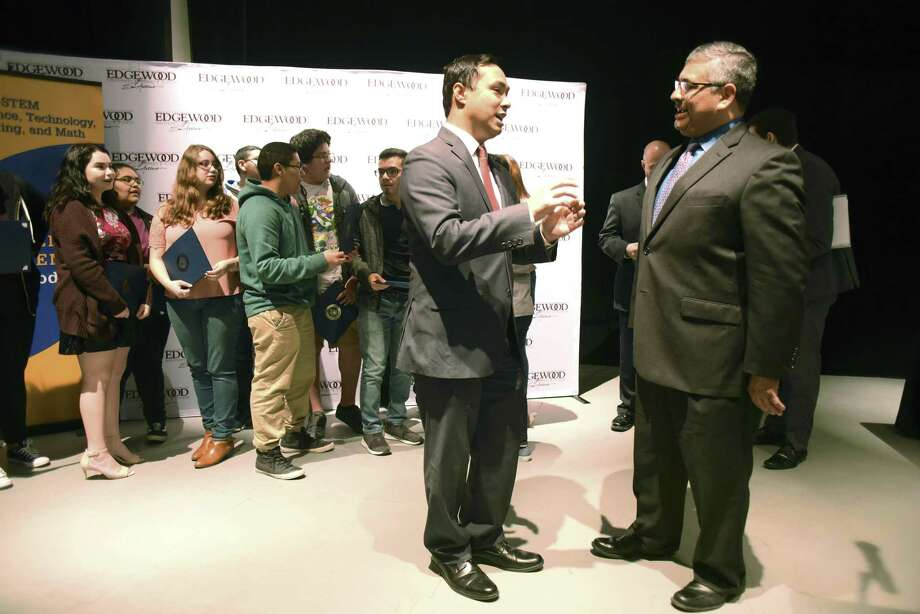 "Phillip Chavez, assistant superintendent for teaching and learning at Edgewood Independent School District, right, speaks with U.S. Rep. Joaquin Castro on Friday, Jan. 12, 2018, after students were honored for apps that they wrote as part of the ""Congressional App Challenge."" Photo: Billy Calzada, Staff / San Antonio Express-News / San Antonio Express-News"