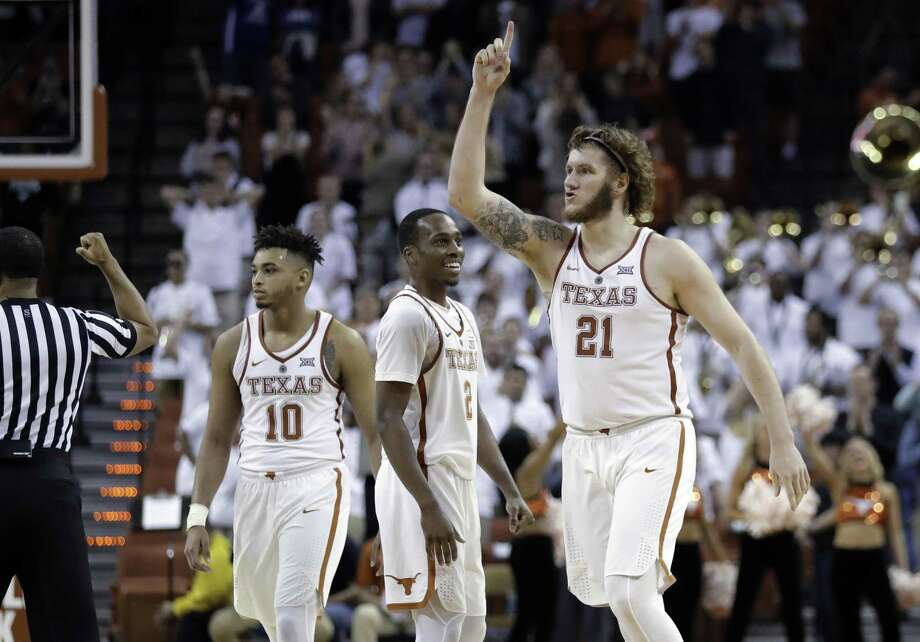 Texas' Eric Davis Jr. (10), Matt Coleman (2) and Dylan Osetkowski (21) celebrate during an NCAA college basketball game against TCU on Wednesday, Jan. 10, 2018, in Austin, Texas. Texas won in double overtime, 99-98. (AP Photo/Eric Gay) Photo: Eric Gay, STF / Associated Press / Copyright 2018 The Associated Press. All rights reserved.