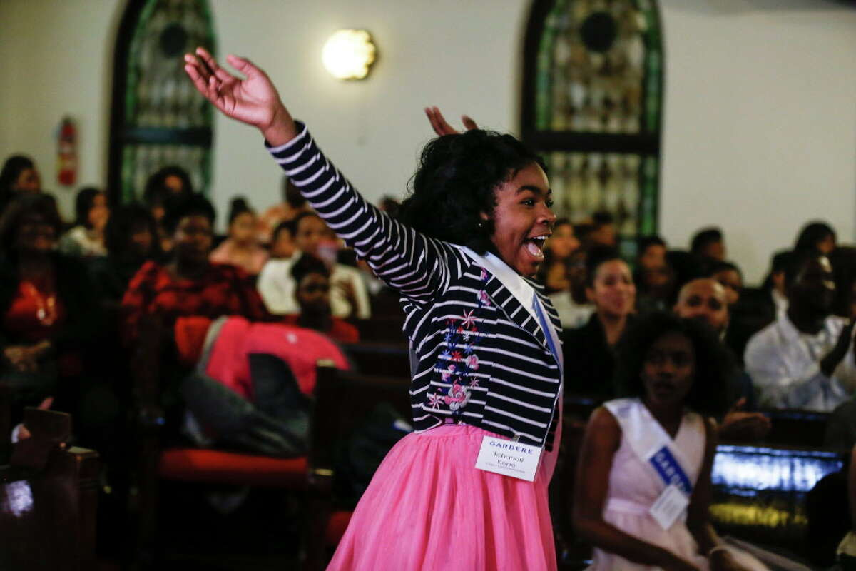 Gregory-Lincoln Elementary student Tchanori Kone jumps for joy after being announced as the winner of the 22nd Annual Gardere MLK Jr. Oratory Competition Friday, Jan. 12, 2018 in Houston.
