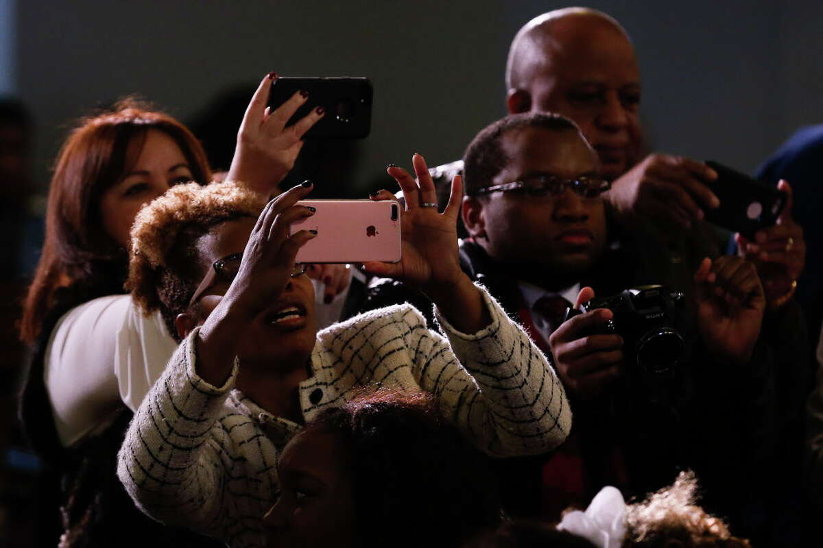 Audience members take pictures of the twelve fourth and fifth grade finalists competeing in the 22nd Annual Gardere MLK Jr. Oratory Competition Friday, Jan. 12, 2018 at the Antioch Missionary Baptist Church in Houston.