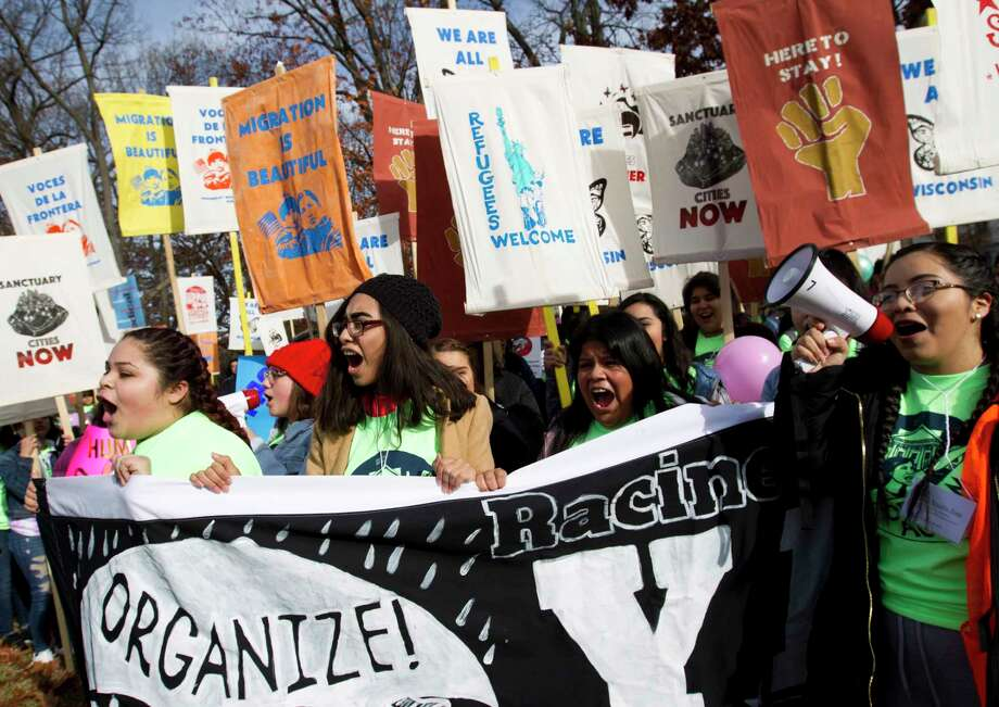 Demonstrators march during an immigration rally in support of the Deferred Action for Childhood Arrivals (DACA), and Temporary Protected Status (TPS), programs, on Capitol Hill in Washington, Wednesday, Dec. 6, 2017. ( AP Photo/Jose Luis Magana) Photo: Jose Luis Magana, FRE / FR159526 AP