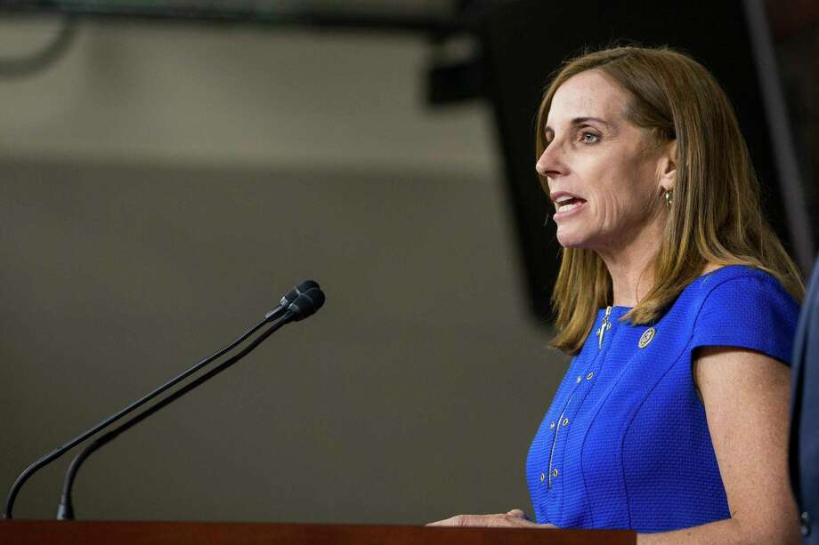 Rep. Martha McSally (R-Ariz.) speaks at a news conference regarding a new immigration bill he introduced with other lawmakers on Capitol Hill in Washington, Jan. 9, 2018. President Donald Trump on Wednesday assailed a federal judge's ruling ordering the administration to restart the Deferred Action for Childhood Arrivals program. (Erin Schaff/The New York Times) Photo: ERIN SCHAFF, STR / NYTNS