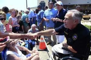Texas Gov. Greg Abbott shakes hands in Rockport, Texas at the First Baptist Rockport on Aug. 31. His appointments to state boards and commissions do not reflect the fact that the state is majority-minority in population.