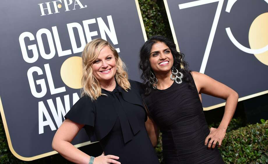 Amy Poehler and Restaurant Opportunities Center United President Saru Jayaraman arrive for the 75th Golden Globe Awards on Jan. 7, 2018. Photo: VALERIE MACON, AFP/Getty Images