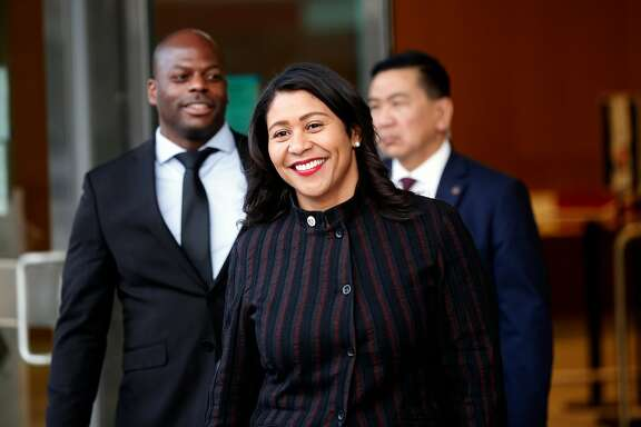 San Francisco's acting Mayor London Breed leaves the building with staff after announcing her intentions to endorse a plan to rename Portsmouth Square Plaza in Chinatown after Mayor Ed Lee, during a Portsmouth Square Plaza community meeting, on Thursday, Jan. 11, 2018 in San Francisco, Calif.