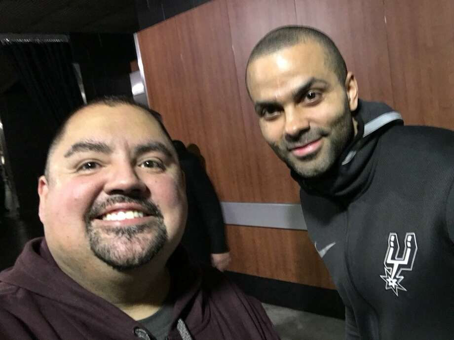 "Gabriel ""Fluffy"" Iglesias provided mySA.com this photo he took with Spurs' Tony Parker in Los Angeles after photos surfaced of the comedian sitting courtside at the Staples Center wearing a Lakers shirt, Jan. 11, 2018. Iglesias told mySA.com the Spurs are ""#1"" and the Lakers paid him to sit courtside with the shirt. (Keep clicking to see all the other celebs at Thursday's game) Photo: Gabriel Iglesias"