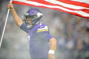 MINNEAPOLIS, MN - NOVEMBER 19: Case Keenum #7 of the Minnesota Vikings carries the flag as he runs onto the field during player introductions before the game against the Los Angeles Rams on November 19, 2017 at US Bank Stadium in Minneapolis, Minnesota. (Photo by Hannah Foslien/Getty Images)