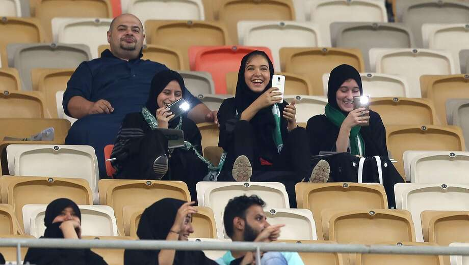 Female Saudi supporters of Al-Ahli attend their team's soccer match against Al-Batin in the Saudi Pro League in Jeddah, Saudi Arabia. Photo: STRINGER, AFP/Getty Images