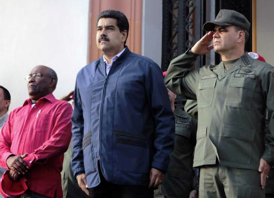 Venezuelan President Nicolas Maduro, center, with Venezuelan vice president Aristobulo Isturiz, left, and Defense Minister Vladimir Padrino Lopez, right, in Caracas in 2016. What do leaders of Venezuela, Poland and the Philippines have in common? They got in power through the ballot box and have become autocrats. Trump, a new book says, shares some traits. Photo: PRESIDENCIA /AFP /Getty Images / AFP