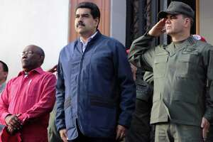 Venezuelan President Nicolas Maduro, center, with Venezuelan vice president Aristobulo Isturiz, left, and Defense Minister Vladimir Padrino Lopez, right, in Caracas in 2016. What do leaders of Venezuela, Poland and the Philippines have in common? They got in power through the ballot box and have become autocrats. Trump, a new book says, shares some traits.