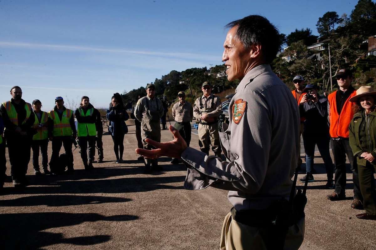 Darren Fong an aquatic ecologist with the National Parks Service briefs the team before the release nearly 200 adult Coho Salmon into Marin County's Redwood Creek to boost spawning of the endangered fish, at Muir Beach, on Friday, Jan. 12, 2018 in Mill Valley, Calif..