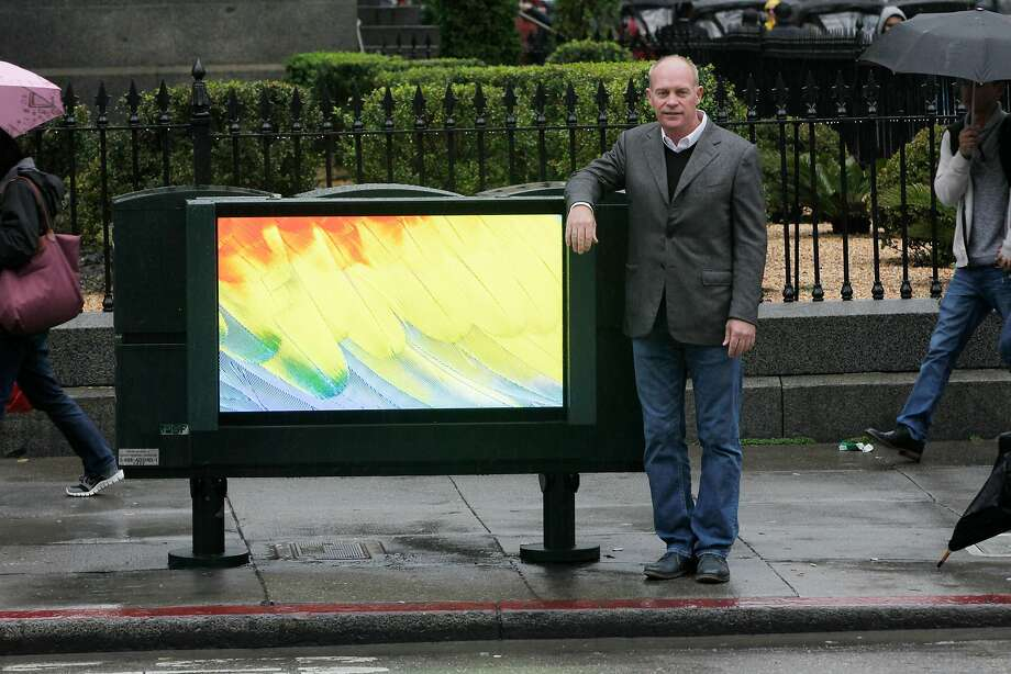 Bob Schmitt, Northern California regional president of Clear Channel Outdoor , with one of the digital billboards the company is installing on the back of news paper racks around San Francisco. Photo: Lea Suzuki, The Chronicle