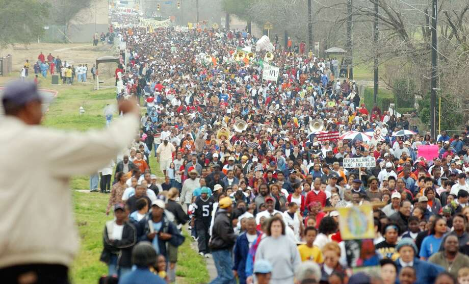 Thousands of marchers fill the streets of San Antonio's East Side during the city's annual Martin Luther King march and rally in 2003. Today, widespread economic segregation has replaced racial segregation, with poverty issues consigned to the margins of political discourse. Photo: File Photo / San Antonio Express-News / SAN ANTONIO EXPRESS-NEWS
