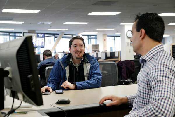 Gustav Choto, left, talks with Omar Masry, the Senior Analyst at the Office of Short Term Rentals in San Francisco, Calif., on Wednesday, January 10, 2018. San Francisco residents who wish to host guests host guests  through Airbnb, VRBO or other homesharing services must register with SF by Jan. 16 or they will be penalized by the city.