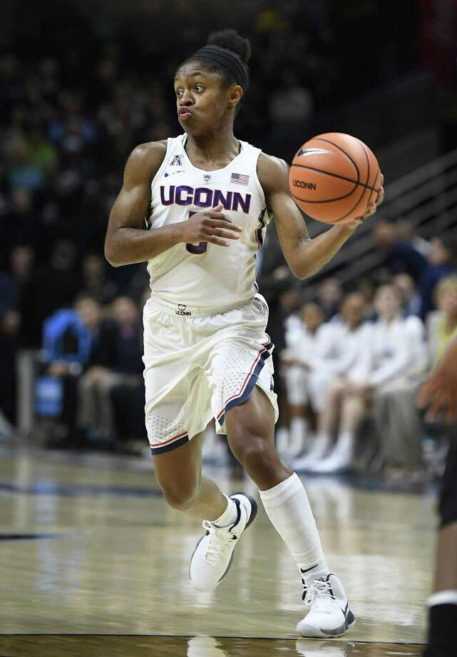 UConn's Crystal Dangerfield looks to pass during a game earlier this season. Photo: Jessica Hill / Associated Press / AP2018