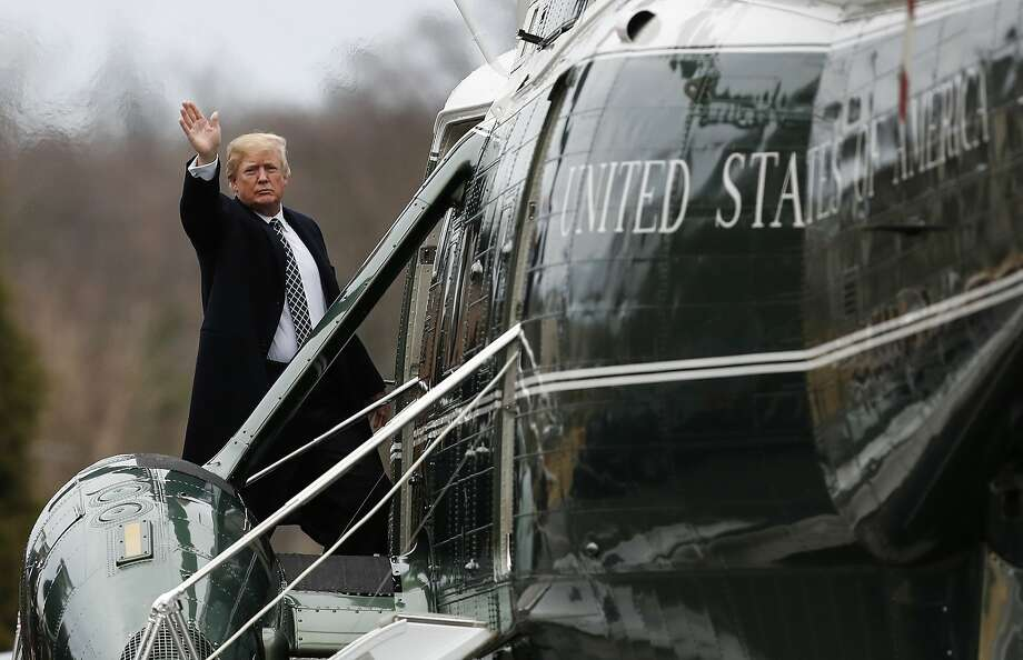 President Trump waves after leaving Walter Reed National Military Medical Center in Bethesda, Md., following his first medical check-up as president. The examination lasted several hours. Photo: Carolyn Kaster, Associated Press