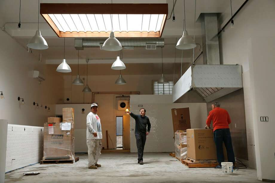 Contractor Ricardo Lizama (left) works with Dan and Raul Mills on Tinker Kitchen. Photo: Michael Macor, The Chronicle