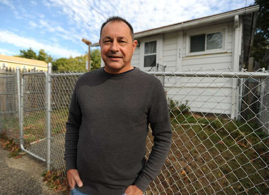 """Bridgeport Park Police Officer Michael Bouchard, of Derby, stands outside 966 Lindley Street, which has been described as haunted, in Bridgeport, Conn. on Tuesday, October 31, 2017. Bouchard featured his experience visiting the house as a police officer in his book """"So You Want to be a Cop?"""", one of three books he has self-published this year. Photo: Brian A. Pounds / Hearst Connecticut Media / Connecticut Post"""