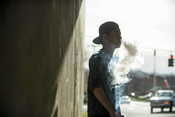 A teen smokes an e-cigarette in Peekskill, N.Y. A reader thinks the emphasis on restricting the sale of alcohol should be as great as on the focus on e-cigarettes.