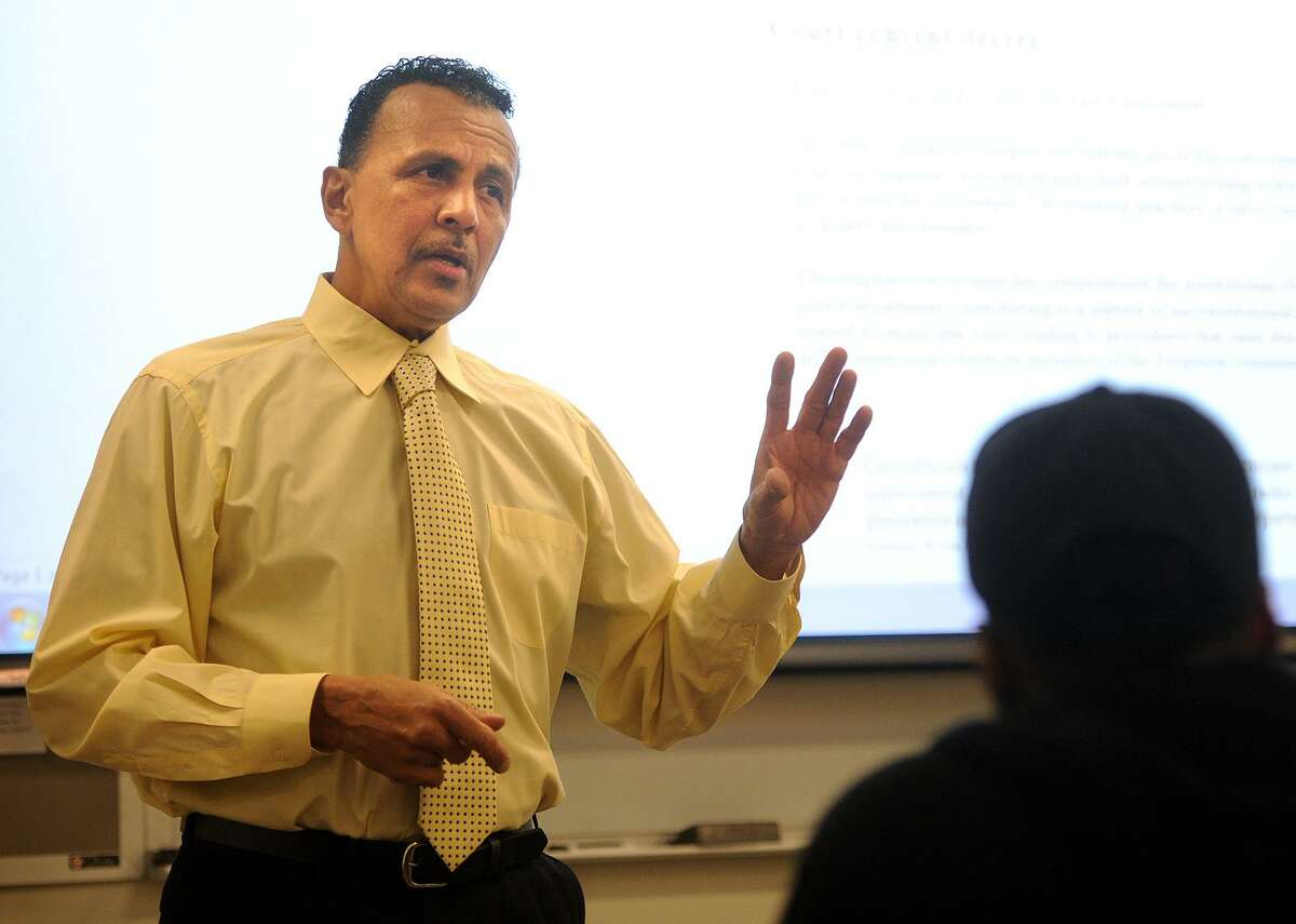 Former Bridgeport Police Lt. Ron Bailey teaches one of his criminal justice classes at Housatonic Community College in Bridgeport, Conn. on Thursday, October 12, 2017. Bailey recently published a book about his years on the force as an African American.