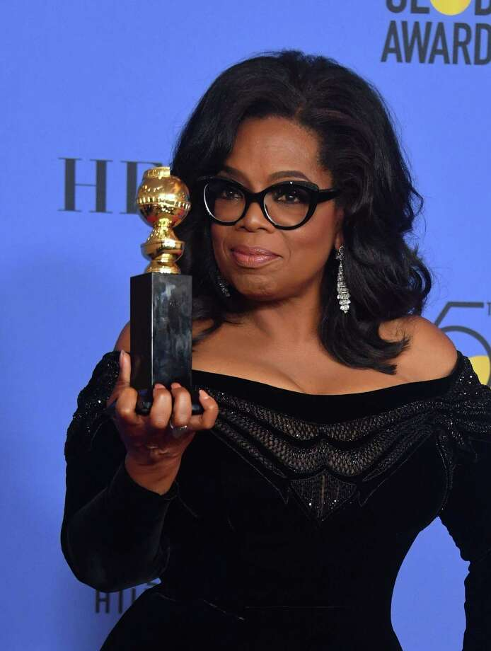Actress and TV talk show host Oprah Winfrey poses with the Cecil B. DeMille Award during the 75th Golden Globe Awards on Sunday. After what may hereafter be called her Golden Globes Address, her name and the presidency were spoken of in the same sentence. Photo: FREDERIC J. BROWN /AFP /Getty Images / AFP or licensors
