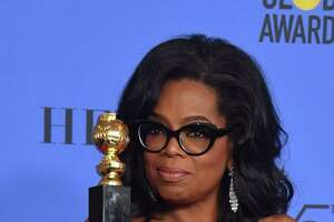 Actress and TV talk show host Oprah Winfrey poses with the Cecil B. DeMille Award during the 75th Golden Globe Awards on Sunday. After what may hereafter be called her Golden Globes Address, her name and the presidency were spoken of in the same sentence.