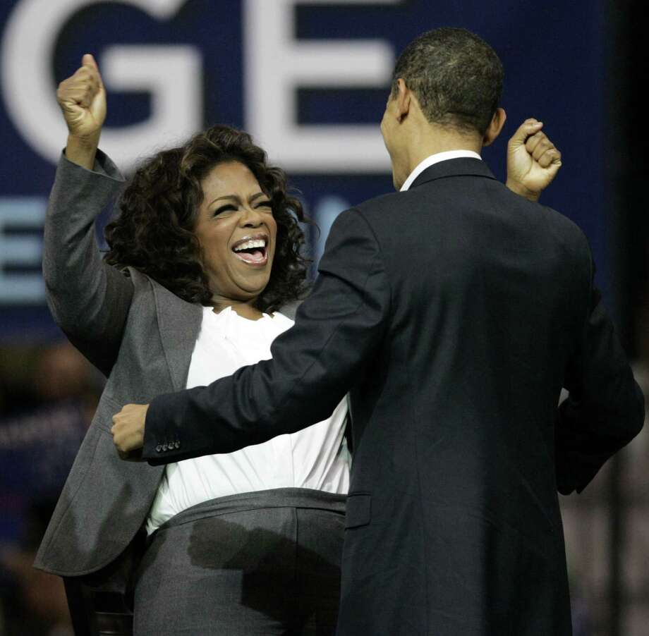 Oprah Winfrey, left, reacts after Democratic presidential hopeful Sen. Barack Obama, D-Ill. spoke at a rally in Manchester, N.H. in 2007. She is now being talked about as a presidential aspirant. Photo: Elise Amendola /AP / AP