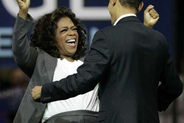 Oprah Winfrey, left, reacts after Democratic presidential hopeful Sen. Barack Obama, D-Ill. spoke at a rally in Manchester, N.H. in 2007. She is now being talked about as a presidential aspirant.