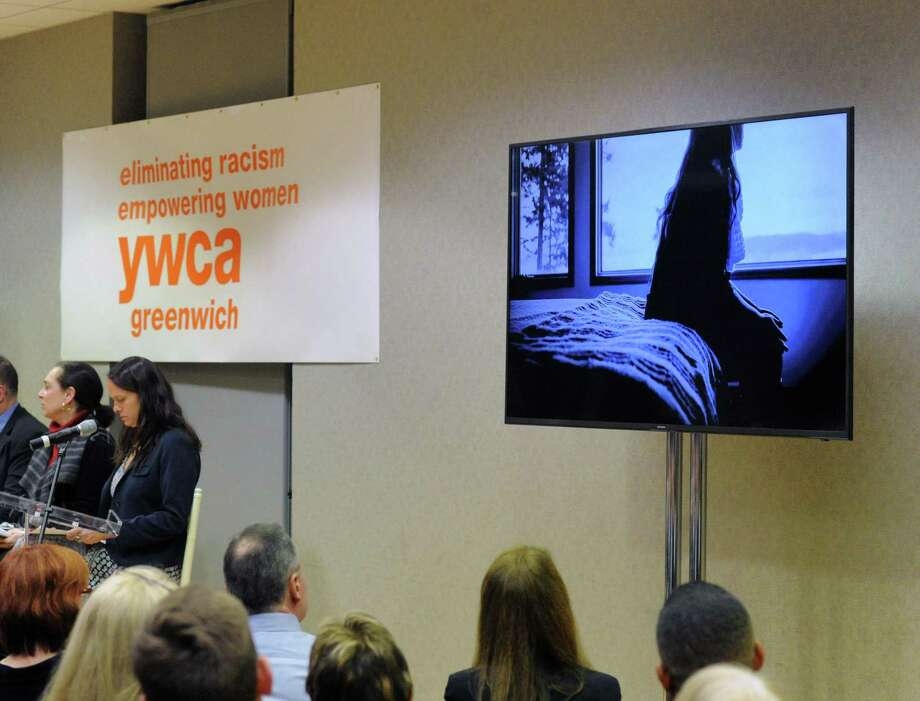 A video about child sex trafficking was shown during the YWCA of Greenwich panel discussion and community conversation about the battle against child sex trafficking and human trafficking at the YWCA in Greenwich, Conn., Thursday night, Jan. 11, 2018. According to Mary Lee Kiernan, the president and chief executive officer of the YWCA of Greenwich, the event was held to pay tribute to and honor the legacy of Dr. Martin Luther King, Jr., by focusing on a topic he would have cared deeply about. Photo: Bob Luckey Jr. / Hearst Connecticut Media / Greenwich Time