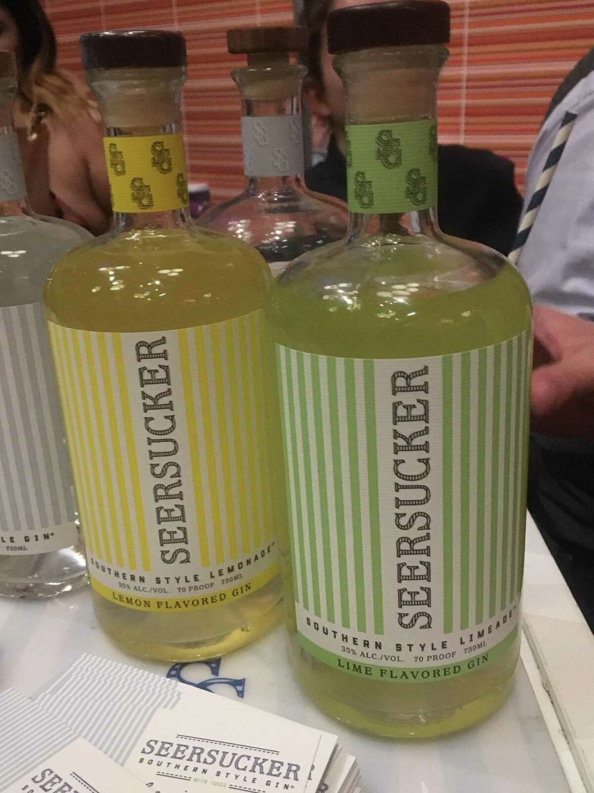 """A new Seersucker line of lime and lemon flavored gins are expected to make their market debuts as early as March 1. The news was announced on Thursday at the """"Opening Night at the Doseum"""" event of the 2018 San Antonio Cocktail Conference."""