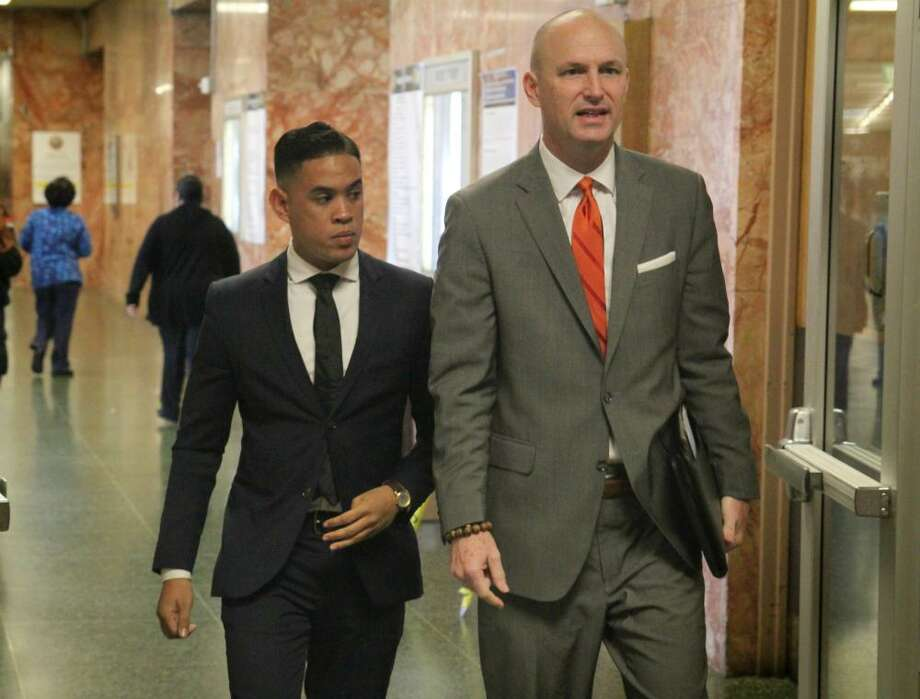 Justin McCall, left, arrives at the San Francisco Hall of Justice on Friday to face arraignment on two sex assault charges. He pleaded not guilty. Photo: Evan Sernoffsky, The Chronicle / /
