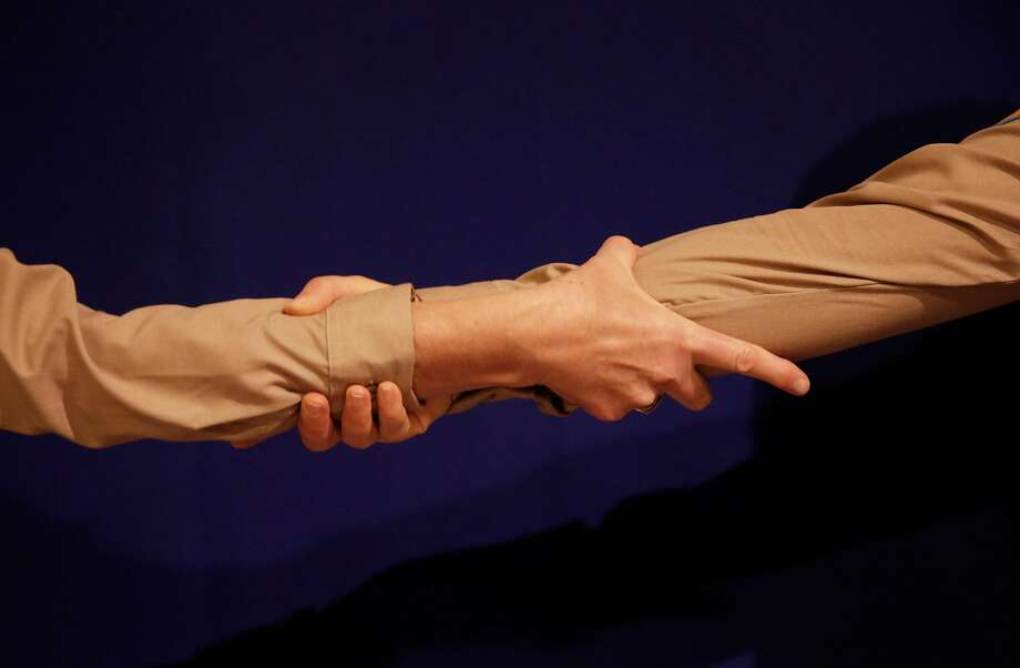Alison Pebworth and Hannah Ireland demonstrate different types of handshakes. Photo: Jessica Christian, The Chronicle