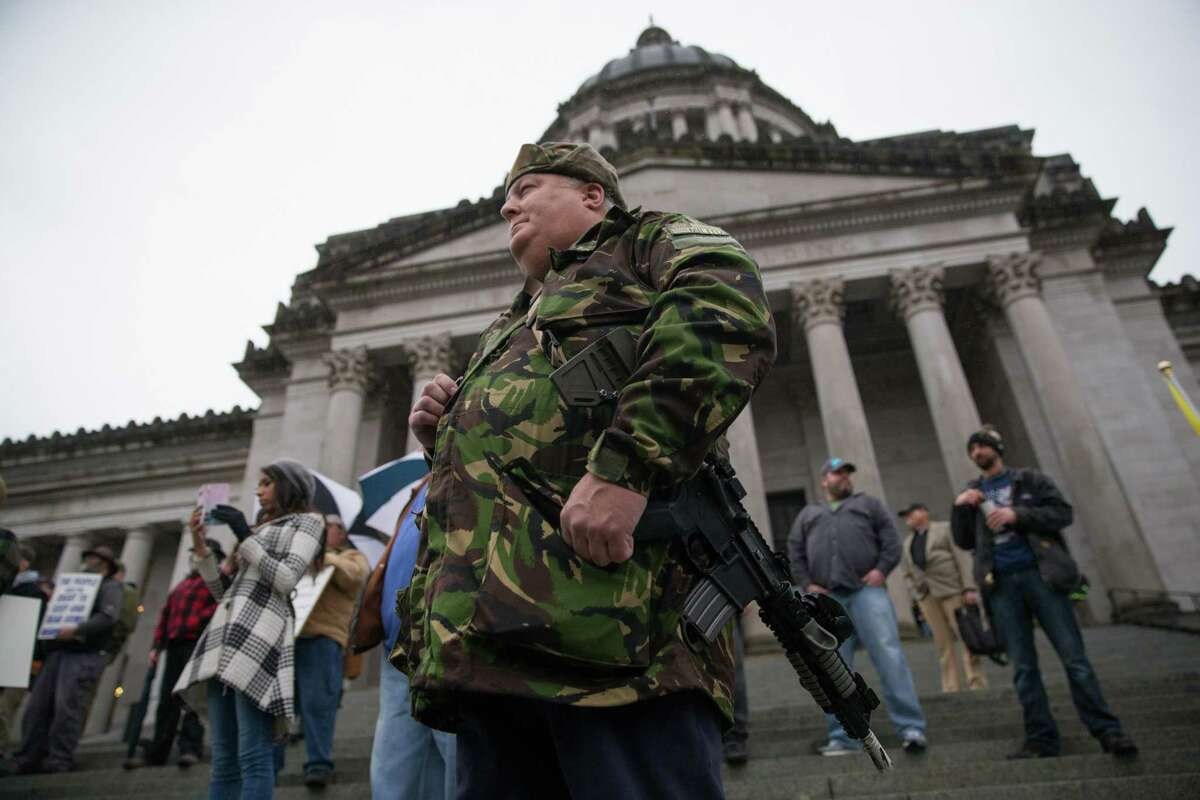 A group of gun rights advocates gathers for the annual Rally 4 UR Rights outside the Washington State Capitol building on Friday, Jan. 12, 2018. The event gives attendees a chance to exercise their right to bear arms in a group, as well as a chance to reach out to representatives for their cause.