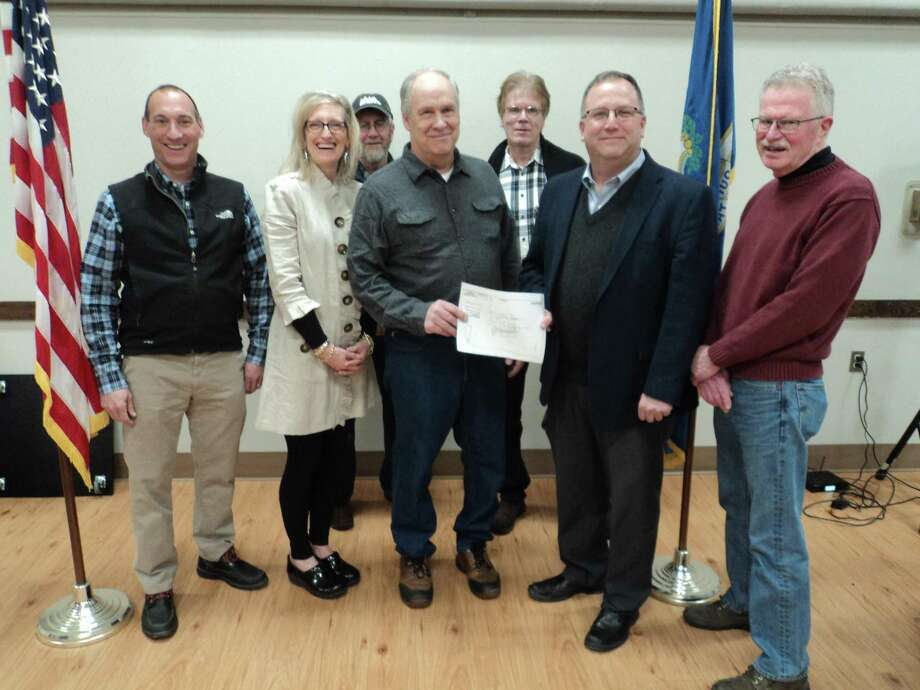 From left,Mark Smaldone, Patti Smaldone, Tom Morrow of the Whigville Preservation Group, Bob King, developer, Ted Shafer, First Selectman of Burlington, Paul Rochford and Tom Finan of the Burlington Land Trust. Photo: Contributed Photo