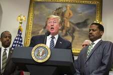 "President Donald Trump, HUD Secretary Ben Carson, left, and Isaac Newton Farris Jr., the nephew of Martin Luther King Jr., at an event honoring King at the White House Friday. Afterward, Trump ignored a question from a reporter about his comments on African and other countries being ""shitholes."""