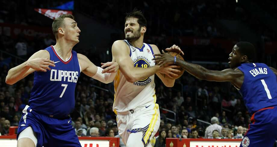 Golden State Warriors forward Omri Casspi, center, drives between Los Angeles Clippers forward Sam Dekker, left, and guard Jawun Evans during the second half of an NBA basketball game in Los Angeles, Saturday, Jan. 6, 2018. The Warriors won 121-105. (AP Photo/Alex Gallardo) Photo: Alex Gallardo, Associated Press