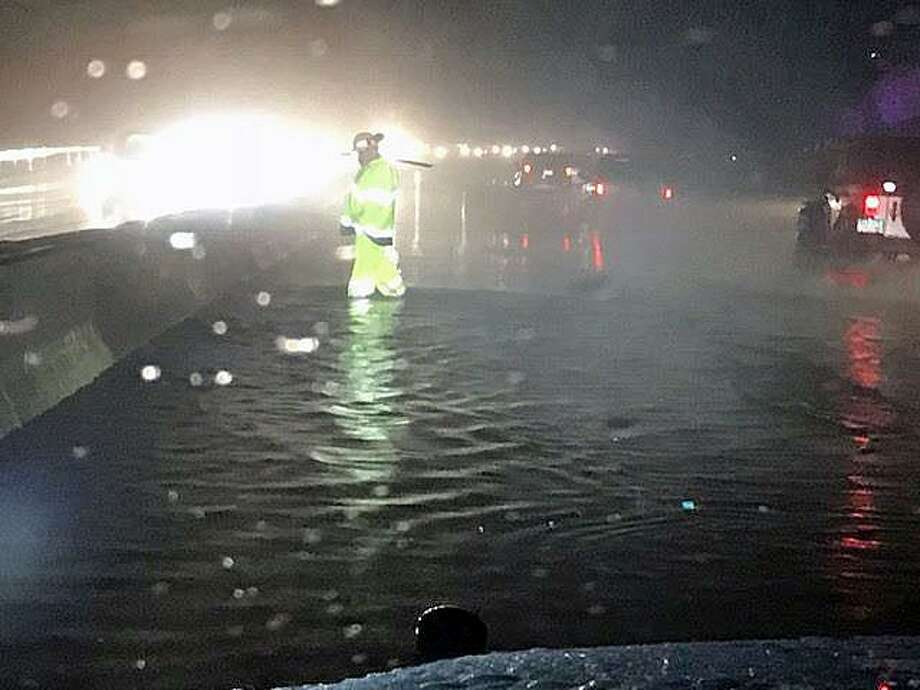 Flooding has closed one of the lanes of Route 8 southbound Friday evening in Seymour, according to Connecticut State Police. The flooding in Seymour, Conn., was reported Jan, 12, 2018. Photo: Contributed Photo / Connecticut State Police / Contributed Photo / Connecticut Post Contributed