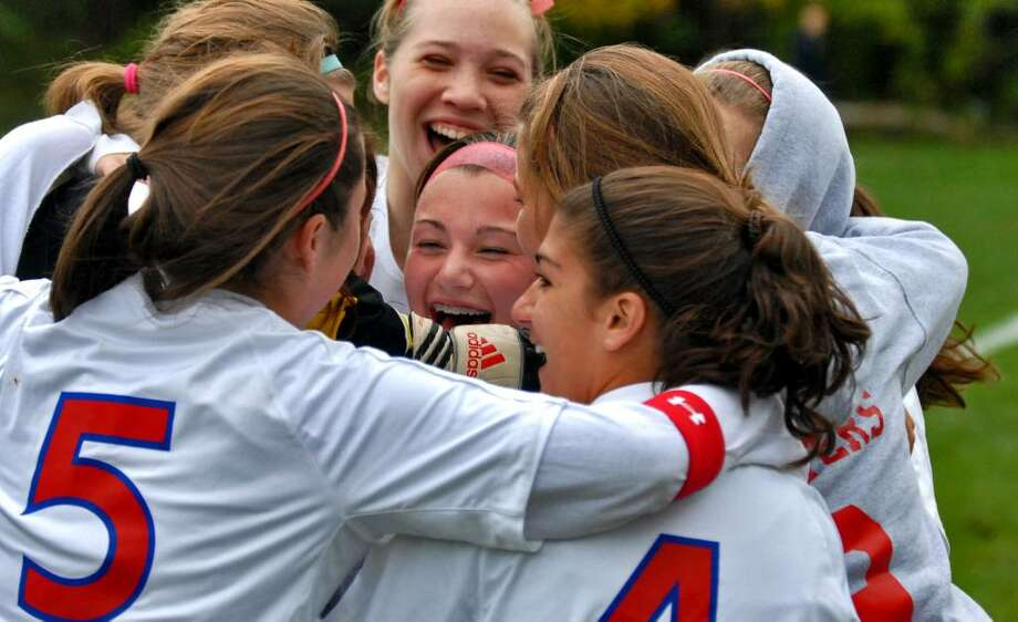 Maple Hill's Meeghan Arno, center, is surrounded by teammates after scoring a goal to break the school's all-time scoring record during a victory over Taconic Hills. (Philip Kamrass / Times Union) Photo: PHILIP KAMRASS / 00005694A