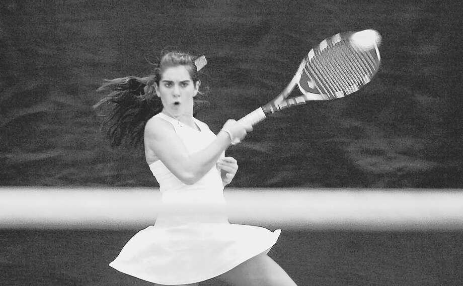 Shaker's Cat Crummey returns the ball during her Section II singles final against Holy Names' Amanda Rosati.  (Paul Buckowski / Times Union) Photo: PAUL BUCKOWSKI / 00005992A