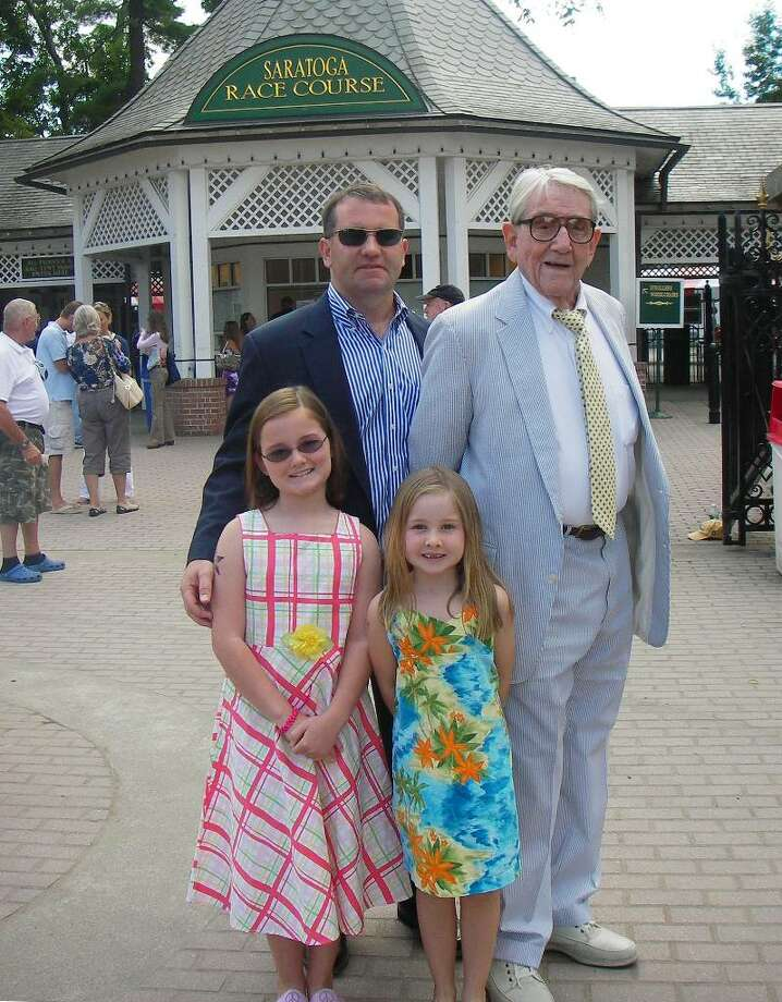 Michael Wales II, left, Michael Collins Wales, age 90, and their daughters/granddaughters Madeline, age 9, and Caroline, age 6 at Saratog Race Course.