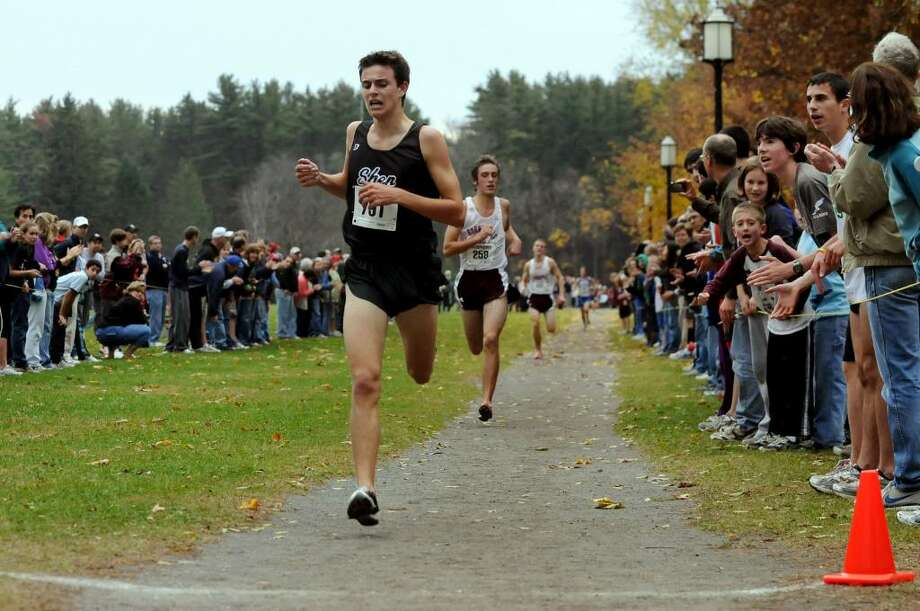 Shenendehowa's Dan Harris approaches the finish first with Burnt Hills' Otis Ubriaco in a close second during the Suburban Council cross country championship at Saratoga Spa State Park. (Cindy Schultz / Times Union) Photo: CINDY SCHULTZ