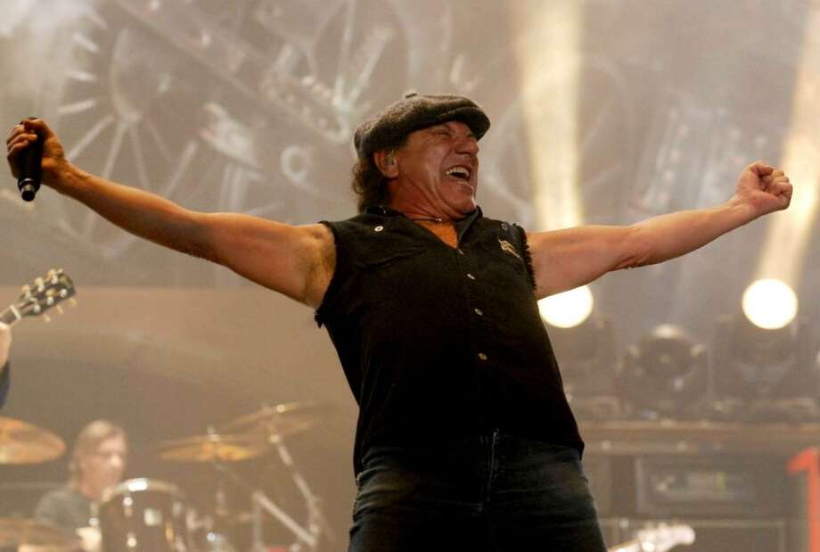 AC/DC, Lead singer, Brian Johnson, performing on stage with the band, at the Times Union Center, on Sunday, Aug. 2, 2009, in Albany, NY.  (Luanne M. Ferris / Times Union) Photo: LMF / 000049055A