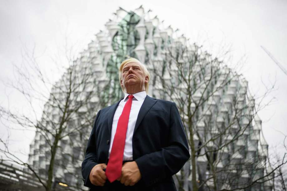 After President Donald Trump canceled his visit to the new U.S. embassy in London, Madame Tussauds 'stepped in,' and placed a model of him there, the wax museum tweeted.  Photo: Leon Neal, Staff / 2018 Getty Images