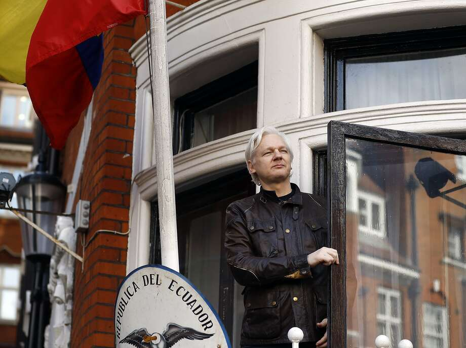 WikiLeaks founder Julian Assange greets supporters in May outside the Ecuadoran Embassy in London. Assange has been living in the embassy in since 2012 to avoid arrest. Photo: Frank Augstein, Associated Press